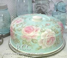 From Jan's Page Of Awesomeness and Originally From  Rose Cottage Chic...  A Lovely Vintage Cake Plate With Cover Painted In Shabby Chic Roses Pattern.