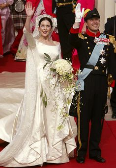 Most Amazing Royal Wedding Dresses Ever.....Crown Princess Mary of Denmark....At her 2004 wedding to Prince Frederik, the bride wore a scoop-neck ivory satin gown designed by Uffe Frank with a veil first used by Crown Princess Margaret of Sweden in 1905.