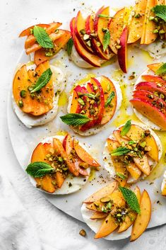 Peach Caprese with Mint, Pistachios, and Honey is the easiest, 7 ingredient appetizer you need for summer! The combination of flavors and fresh ingredients is the most perfect balance of sweetness, acidity, saltiness, and creaminess! It belongs in your arsenal for when you need a last minute, easy & delicious recipe for summer entertaining! #summer #appetizer #peaches #caprese #entertaining
