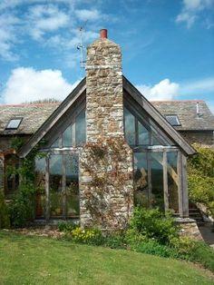 Stone chimney on glazed oak gable to Barn Conversion in Devon