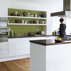 For a contemporary cooker hood and built-in cooker, try Neff. The Abstrakt units are by IKEA. Marks & Spencer stocks retro radios, and B has a range of spotlights. Hardwoodfloorstore.co.uk sells iroko worktops.