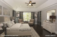 Master bedroom of The Carinthia house plan 1180 built by North Point Custom Builders! #WeDesignDreams #DonGardnerArchitects