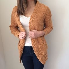 Cozy Cardigan Super cozy and flattering knit-style cardigan in a smokey orange color. Sweaters Cardigans