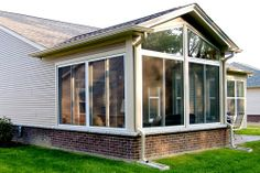 Insulated sunroom with conventional wood roof.
