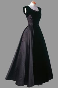 Black velvet and silk dress with deep décolleté and full skirt    Norman Hartnell    This dress shows the influence of the 'New Look' introduced by Christian Dior in 1947, which combined a narrow waist with full skirts. (Worn by Queen Elizabeth II)
