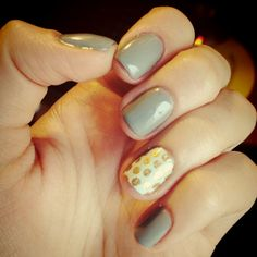 Simple grey with turquoise and gold polka dot accent nail