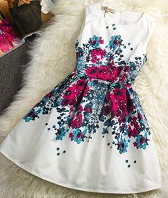 White and print a-line dress. Love the blue and purple fun print. Great spring or summer dress