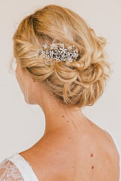 Loose updo with floral hair comb