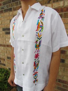 Hand embroidered by indigenous women in Mexico - Made of linen and with Mother of Pearl buttons. One of a kind.