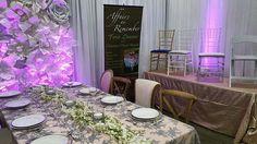 Lalani Silver Overlay, Blush Satin, Glitz overlays, Chiavari Chairs and a stunning Flower Wall with purple uplighting!