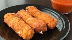 Mozzarella Stick Chicken Fries - Mozzarella sticks are wrapped in seasoned ground chicken, then breaded and deep fried.