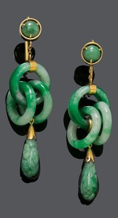 A PAIR OF ANTIQUE JADEITE EAR PENDANTS, ca. 1900. Each set with one round jadeite cabochon, suspending three interlocking jadeite-rings and one carved pear-shaped jadeites, mounted in rose gold.