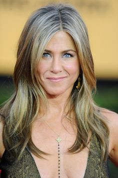 Jennifer Aniston letting her gray show?! Looks fantastic.