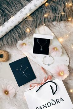What's on your Christmas wishlist this year? We're adding the beautiful PANDORA Bright Star pendant and charm from our new Christmas collection to ours! Photo credit: blogger Masha Rotar.