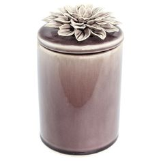 Ceramic trinket box in brown with a decorative flower accent.    Product: Trinket boxConstruction Material: Cer...