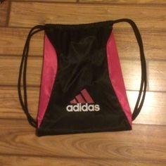 Description  Pink and black bag. 4d6855b90a4c5