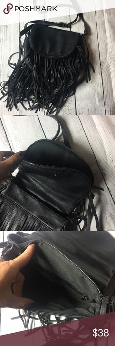 """❤️Gorgeous black fringe shoulder 👛 Absolutely stunning black fringe. Used a handful of times but it is too small for me😞 but this purse is super cute and stylish. Got a ton of compliments every time I wore it. Width 9"""" and length 7.5"""". Has an adjustable strap to make shorter or longer dowsing on what you are going for. No signs of wear or tear. Made out of faux leather but it is soft on ones skin. Has two pockets but I especially love the one that on the flap of the purse as shown in the…"""