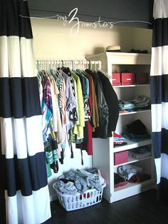 """Forget closet doors, closet curtains are cooler! Amy of """"My 3 Monsters"""" even made the bookcase storage piece double as a closet rod holder. So much win :D #makeover"""