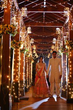 Wedding and Sangeet Decor - Cocktail Decor with Fairy Lights and Mason Jars and Hanging Flower Bouquets | WedMeGood | #wedmegood #decorideas #DIY #indianwedding #fairylights