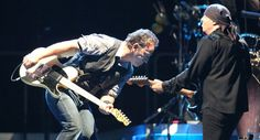 Bruce Springsteen, left, and Steven Van Zandt, right, trade guitar licks as the E Street Band performs at Citizen's Bank Park. 09-04-12