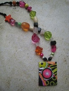 Handmade paper pendant and beaded to this adorable necklace for a young girl