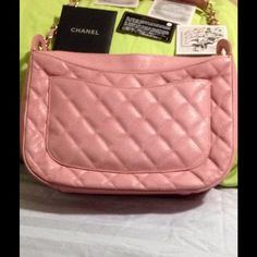HP 7/24 HP 8/27 Pink CHANEL caviar hobo This is an authentic CHANEL Caviar Quilted Hobo Pink. The bold design and exceptional quality of this Chanel hobo lend a look of classic elegance for day or evening. The hobo is uniquely structured and crafted of rich and luxurious diamond quilted pink caviar leather with texture and depth. This bag has a gold chain link strap threaded with pink leather and a pink leather shoulder pad. The front of the bag has a large Chanel CC patch and the back has a…