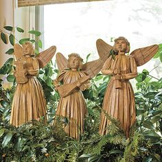Rustic Cottage. Arrangement of greenery and handcrafted corn husk angels.