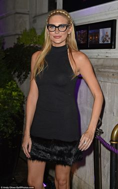 Specs appeal: Stephanie Pratt matched her cat eye frames to her black minidress for the Sp...