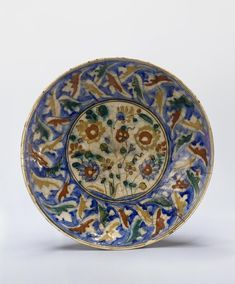 Name:  Dish  Place of creation: Iran  Date: 17th century  Material: faience  Technique:  polychrome painting  Dimension:  diam. 34,7 cm