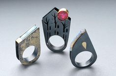 Rings | Barbara Christie. Oxidised silver, with 18 ct yellow gold detail, Georgian red past glass stone, boulder opal, clear aquamarine stone.