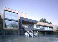 This house sits on the banks of the river Loddon near Wargrave England but as you can see flooding sometimes causes it to sit directly IN the river. It was designed by the award-winning firm John Pardy Architects. Built as a one-off residence it is known as Hind House. The house is designed with three modularized spaces each in a separate wing and each serving a different function: living spaces, sleeping spaces, and guest accommodations. It is built on columns to deal with the flooding…