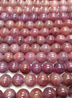 7mm Ruby Beads by Strand, Natural untreated color. Opaque Rubies are much less costly than clear gemstone quality beads. #ruby #rubies #gemstones #crystals #bellafindings #gempacked
