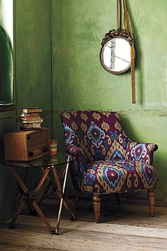 Mix of pattern and texture in the concrete painted walls and ikat chair. #laylagrayce #ikat