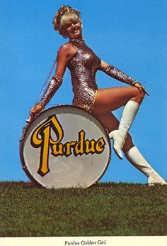 "PURDUE GOLDEN GIRLPURDUE UNIVERSITYWEST LAFAYETTE, INDIANAPURDUE GOLDEN GIRL — The world famous baton twirler appears with the University ""All-American"" marching Band wherever it performs.Does she have a name?"