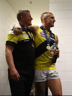 Tigers coach Damien Hardwick and Dustin Martin arrive for a press conference after the Tigers defeated the Crows at the 2017 AFL Grand Final match. Richmond Afl, Richmond Football Club, Cute Bunny Pictures, Room Posters, Pro Cycling, World Of Sports, Day Of My Life, Wall Photos, Crows