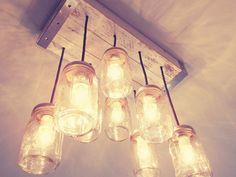 Mason Jar Chandelier- Lighting - Mason Jar Lighting- Ceiling Light, Rustic Lighting, Mason Jar Light, Farmhouse, onsale ---------------------------------------------------------------------------------------------------------------------------  Welcome to Mis & Me!!  We make custom made to order mason jar chandeliers, signs, custom furniture and other creative personalized pieces. This listing is for a custom mason jar chandelier like the one in the pictures. Our custom cottage mason jar ...