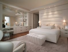 contemporary bedroom by Pepe Calderin. I like recessed lights and mirror on the wall.