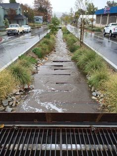 21st Street, Paso Robles, CA by SvR Design Company / Storm water winds between rail baffles designed to evoke the region's railroad history, slow the water flowing through the system, and allow for deposition and removal of sediment. Click image for full profile and visit the slowottawa.ca boards >> http://www.pinterest.com/slowottawa/