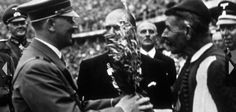 On This Day August Spyridon Louis Presents Hitler With Olive Tree From Olympia - The Pappas Post Berlin Olympics, Greece Pictures, Old Greek, Olympic Games, Olympia, Old Photos, Captain Hat, Hero, Photo And Video