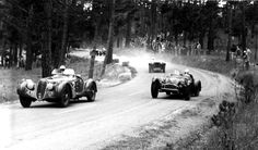 Pebble Beach, 1951. Phil Hill in the ex-Tommy Lee Alfa Romeo 8C2900B leads Bill Pollack in Tom Carstens' #14 Cad-Allard with three MGs following