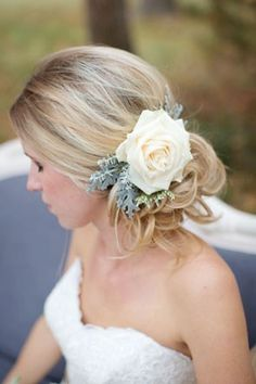we love this #wedding updo with a single white rose. see more blooming #wedding hairstyles here: http://www.mywedding.com/articles/wedding-hairstyles-with-flowers/