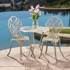 Enjoy the morning paper out on the patio with this classic outdoor bistro set. Constructed from powder-coated aluminum, this sturdy three-piece set features a delightful tulip design that adds beauty and elegance to your outdoor space.