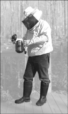 Protective clothing comes in various styles, from minimal to full coverage. This beekeeper uses a v