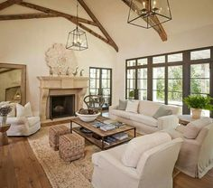 Love the open beams and wall-to-wall windows.