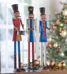 Set Of 3 Decorative Tin Soldiers by Plow & Hearth. $59.99. Set of 3 decorative tin soldiers. The perfect addition to sideboard and mantel displays. Finished with a hint of glitter. Festively decorated and uniquely attired. Hold baton, saber, drum. This troop of colorful metal soldiers will stand sentinel over your holiday decorations! Each tin soldier is uniquely attired, with a drum major, baton in hand, marshaling on his fellows who stand with drum and saber at the ready...