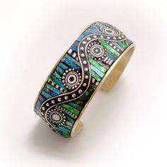 Polymer clay and sterling silver cuff bracelet by LIz Hall. She is amazing!