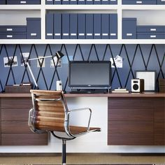 Mix walnut and navy with white for a calm feel, whilst keeping the room sleek and clean with streamlined shapes and matching files and folders. Keep everything you need to hand by putting up open shelving, and use a kitchen worktop to make an economical, extra-long desktop. A pinboard that extends the length of your desktop will keep everything in order.