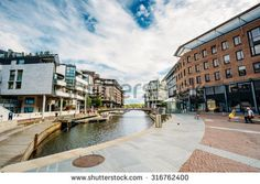 OSLO, NORWAY - JULY 31, 2014: Typical Example Of Scandinavian Architecture. Exterior Building in Aker Brygge is a popular area for for shopping, dining, and entertainment in Oslo, Norway - stock photo