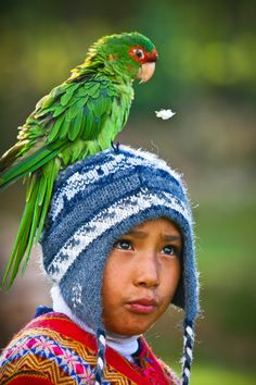 Peruvian Child & Parrot - Peru- - I love this! Is the boy happy? I believe a state of wonder!!! ♥