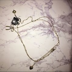 Double chain camera charm gold necklace It is a long gold necklace that that you loop. black camera charm with rhinestones and gold bow with large center rhinestone. worn once AMAZING condition comes with designer Betsy Johnson box Betsey Johnson Jewelry Necklaces